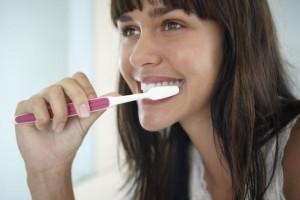 Woman Brushing Her Teethe