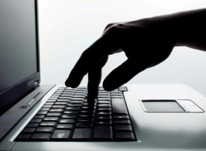 finger pressing keyboard