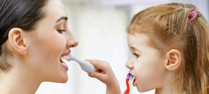 mother-and-daughter-brushing-teeth-708