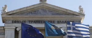 Flags from right, Greek, National Bank of Greece and the European Union flags wave outside the headquarters of the National Bank of Greece in Athens, on Friday, Sept. 23, 2011. Moody's ratings agency downgraded eight Greek banks by two notches Friday due to their exposure to Greek government bonds and the deteriorating economic situation in the country, whose government has struggled to meet the terms of an international bailout. (AP Photo/Petros Giannakouris)