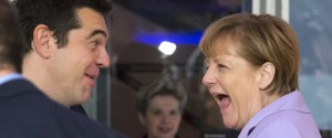 German Chancellor Angela Merkel, right, and Greek Prime Minister Alexis Tsipras share a laugh at the start of a second working session of a summit on migration between European and African leaders, in Valletta, Malta, Thursday, Nov. 12, 2015. (AP Photo/Alessandra Tarantino)