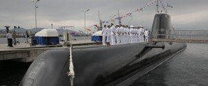 Greek Navy officers of Pipinos submarine stand during a launch ceremony at Skaramanga shipyards near Athens, on Monday, Oct. 6, 2014. Greece launched the submarine Pipinos Monday, the first of three German-designed Type 214 submarines featuring an air-independent propulsion system. Its construction followed years of delays due to legal and technical disputes. (AP Photo/Petros Giannakouris)