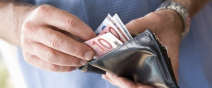 Man counting banknotes in wallet