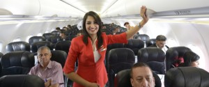 NEW DELHI,INDIA MAY 20: Air Hostess inside the Aeroplane during the launch of Air Asia flight at IGI AirportT3, New Delhi.(Photo by Chandradeep Kumar/India Today Group/Getty Images)
